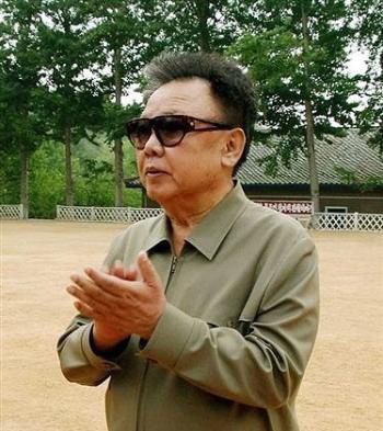 North Korean Premier Kim Jong Il patiently awaits his turn to go down the slide